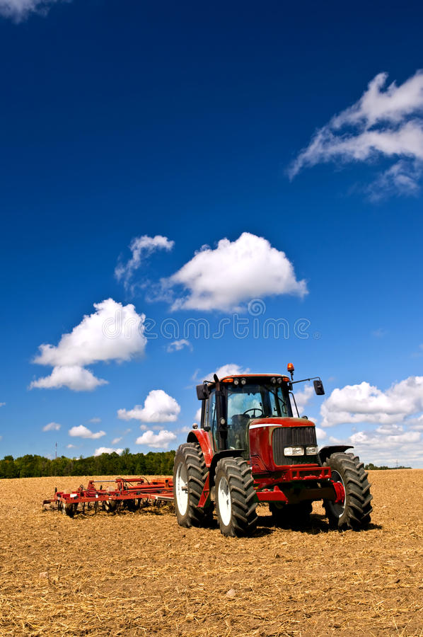 Download Tractor in plowed field stock image. Image of harvest - 12613407