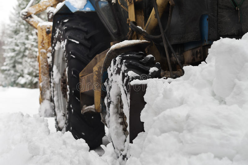 Tractor Plowing Snow stock photos