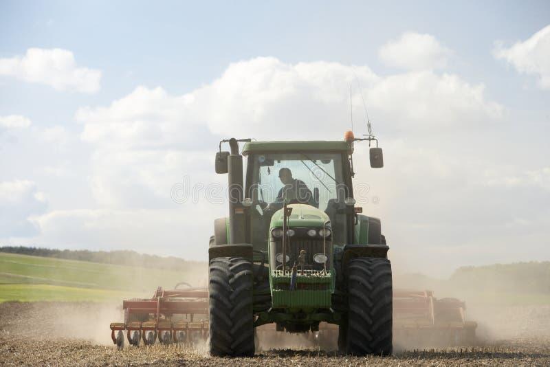 Tractor Preparing Soil. For seeding stock image
