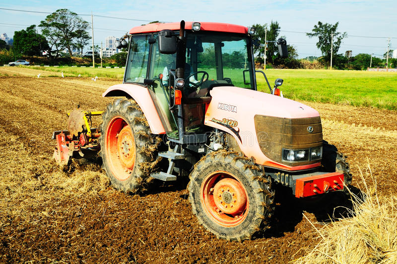 Tractor. A tractor pulling a chisel plow in a field stock photo