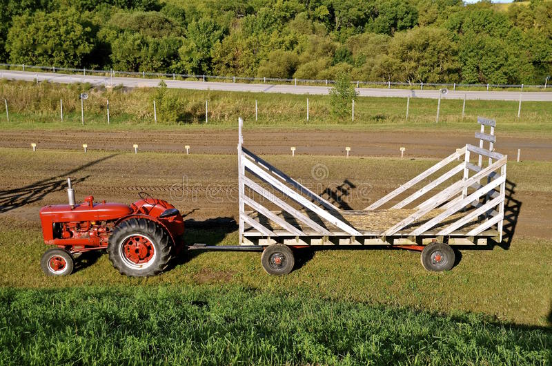 Tractor pulling hay rack. ROLLAG, MN, Sept 10, 2015:A Farmall tractor pulls an empty hay rack at the West Central Steam Threshers Reunion(WCSTR) where 1000's stock photos