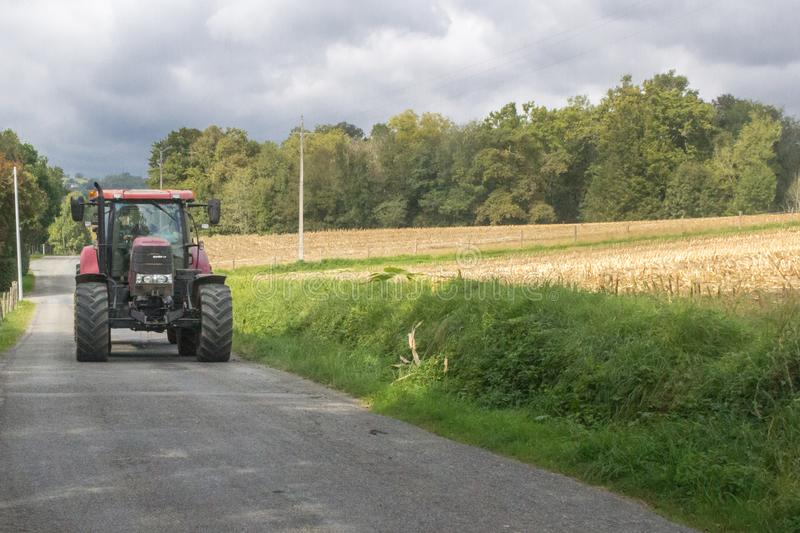 Tractor for agricultural work on a rural road royalty free stock photos