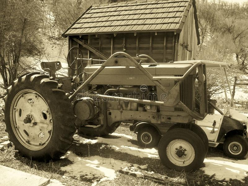 Tractor and shed in Utah park. Farming tractor and shed found in a Utah park royalty free stock images