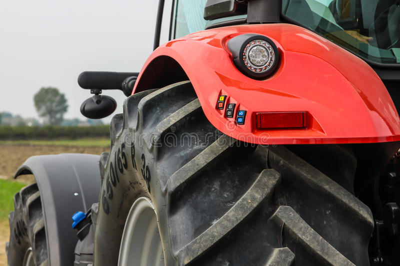 Tractor silhouette on a field royalty free stock photo