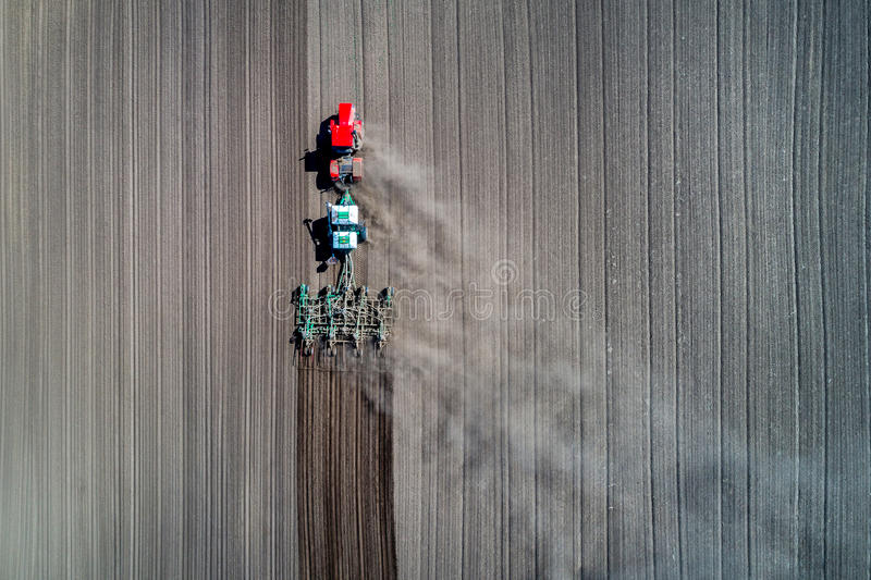 Tractor sowing in the field. Earial view stock photo