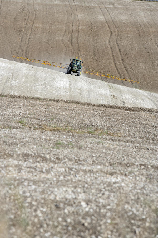 Tractor Spraying Field Royalty Free Stock Photos