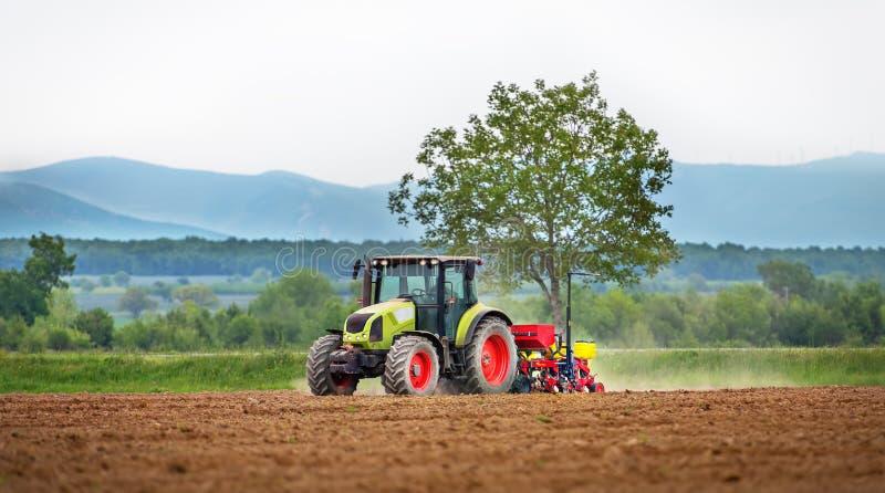 Tractor spraying field. Tractor spraying field at spring stock image
