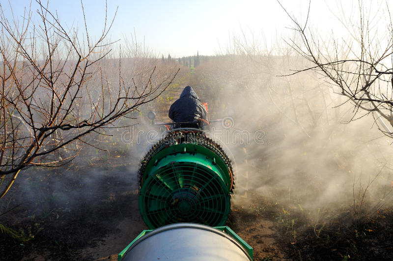 Tractor spraying plantation royalty free stock photos