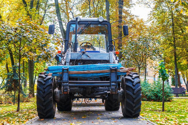 A tractor standing in front of the nature. Tractor Belarus in the forest royalty free stock photography