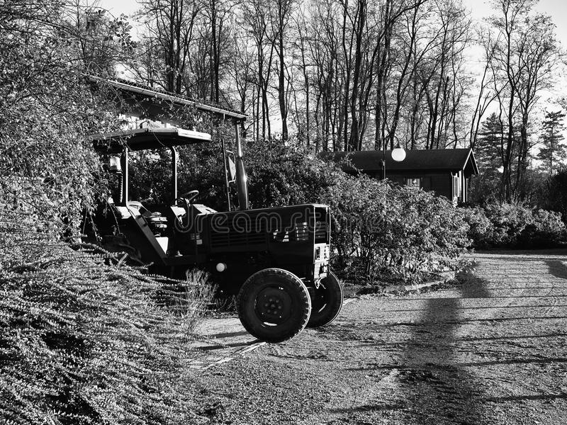 Tractor standing outdoor. Black and White image of tractor standing outdoor stock photography