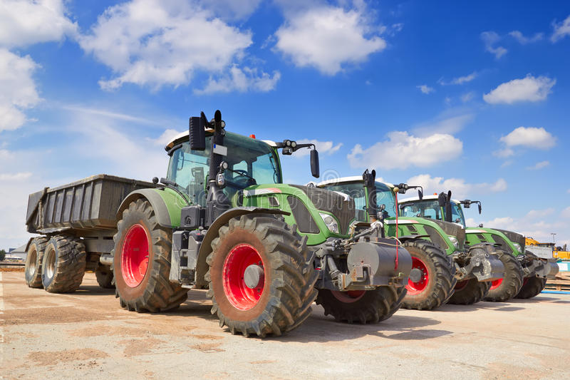 Tractor, standing in a row. Agricultural machinery. Tractor, standing in a row stock photography