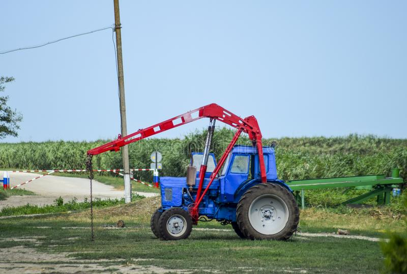 Tractor, standing in a row. Agricultural machinery. Russia, Temryuk - 15 July 2015: Tractor, standing in a row. Agricultural machinery. Parking of agricultural stock photo