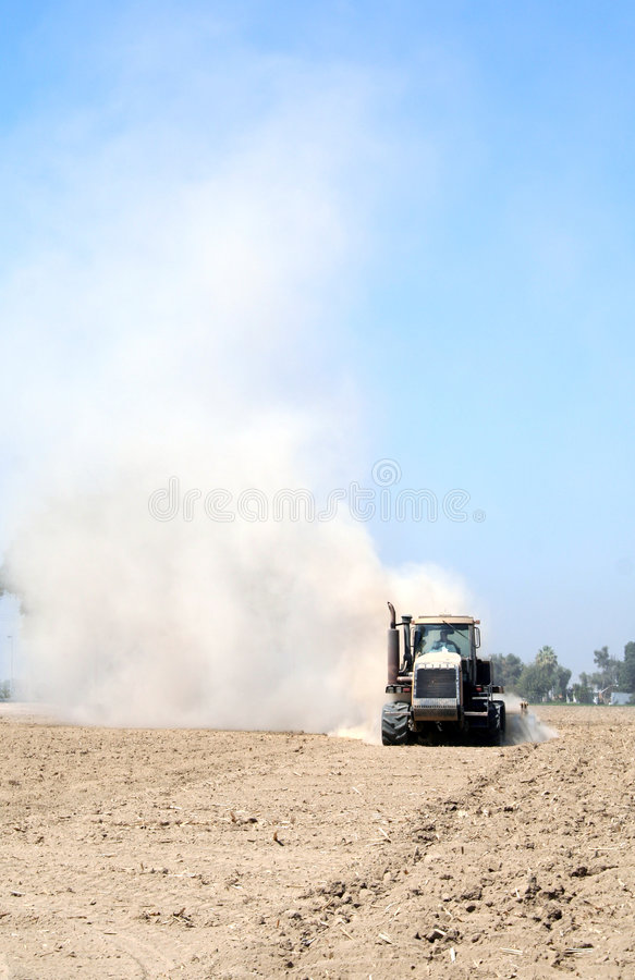 Tractor Tilling stock photography