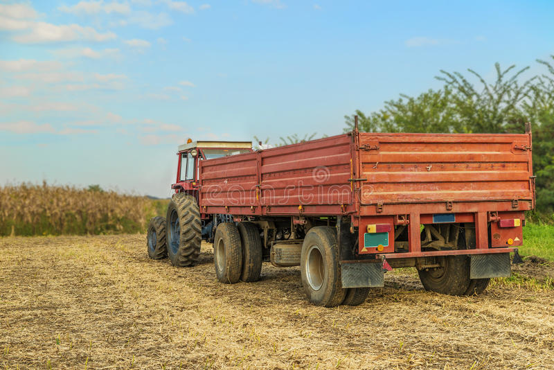Tractor with trailer standing. In a field waiting for harvest stock photography