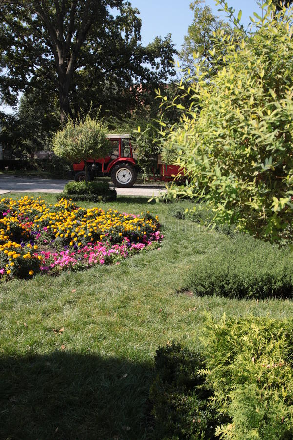 Tractor and the trolley in the park garden royalty free stock photography