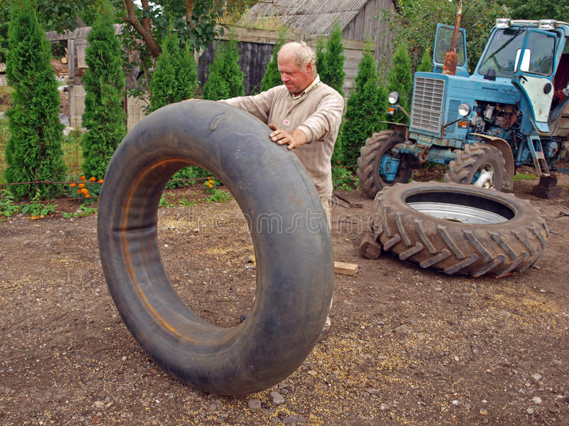 Download Tractor tyre repairing stock photo. Image of tire, tractor - 26396036