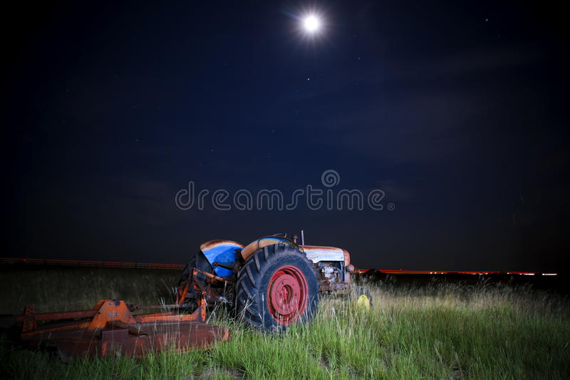Tractor Under Moon royalty free stock photography