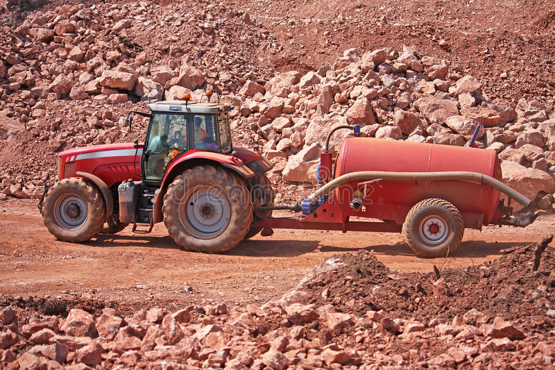 Tractor and Water Bowser. Tractor towing a water bowser royalty free stock image