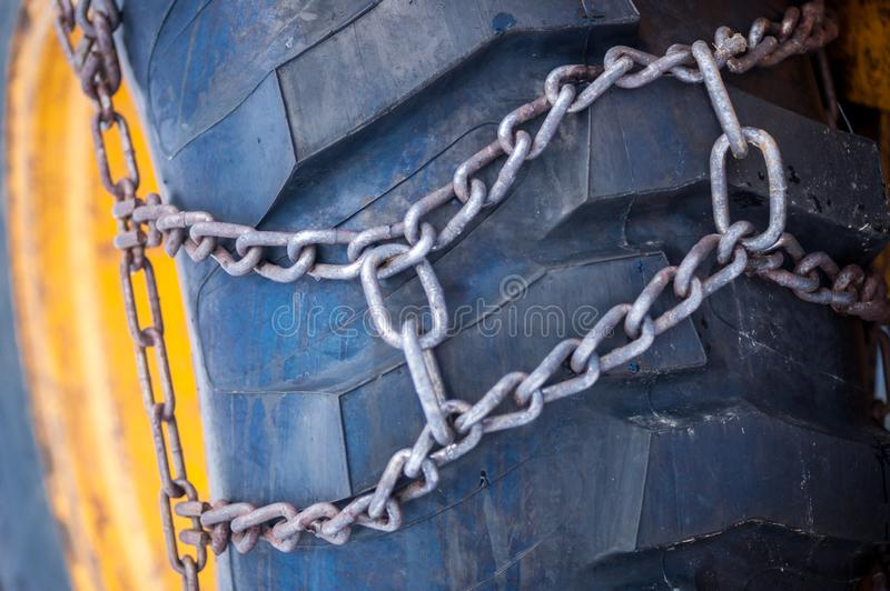 Tractor Winter Chains. A tractor tire with winter chaines is portrayed in this image stock photos