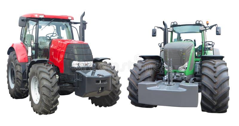 Tractores rojos del extracto y verdes potentes modernos aislados sobre blanco fotografía de archivo libre de regalías