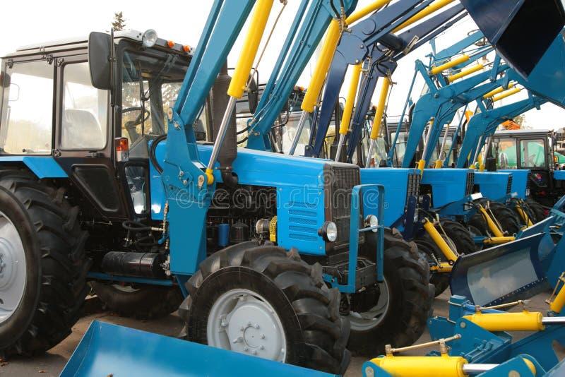 Tractors. A many similar blue Tractors stock image
