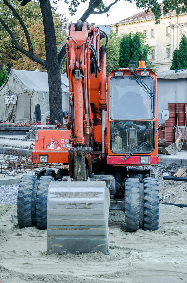 Tractors are digging pits to repair roads in Lviv. Tractors are digging pits to repair roads royalty free stock photography