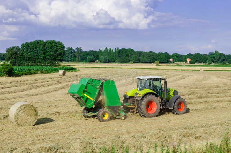 Tractors and harvesting. A Tractors in use at harvest royalty free stock photography