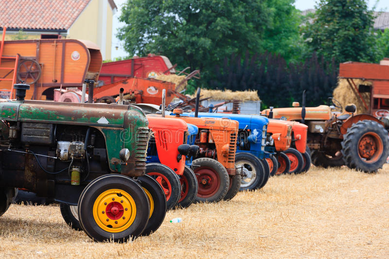 Tractors in perspective. Detail of old tractors in perspective, agricultural vehicle, rural life royalty free stock photos