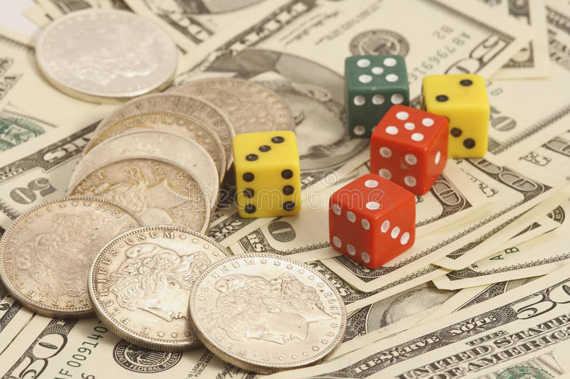 Trade Dollar And Dice Royalty Free Stock Images