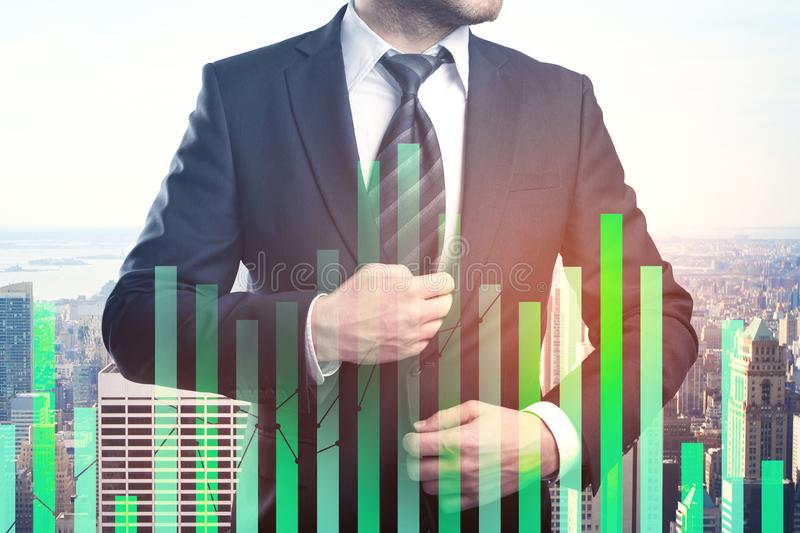Trade, investment and profit concept. Unrecognizable young businessman on abstract city office background with forex chart. Trade, investment and profit concept stock photography