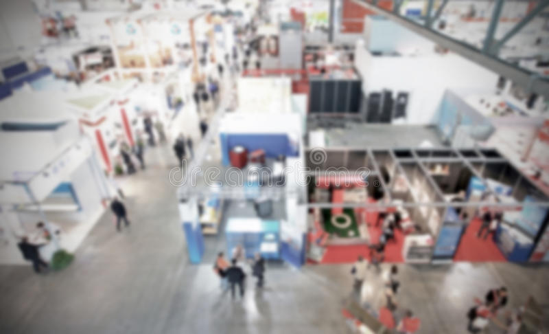Trade show background with an intentional blur effect applied. Humans and location not recognizable royalty free stock photos