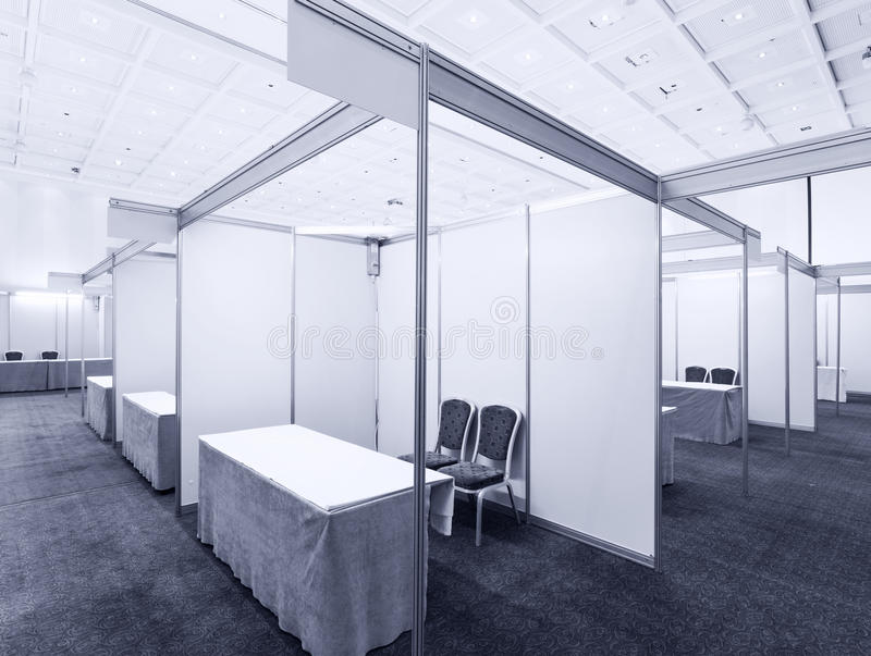 Trade show interior. With booth and tables stock photography