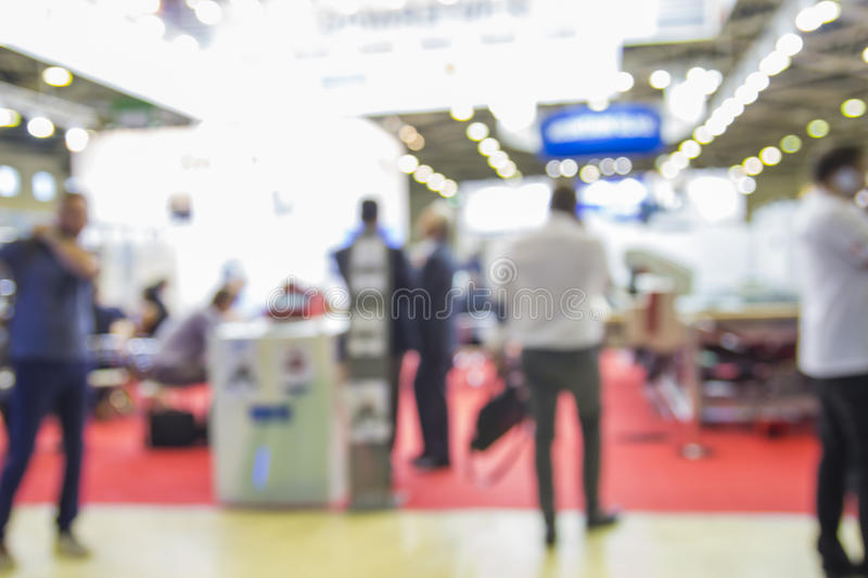 Trade show people. Intentionaly blurred background stock photos