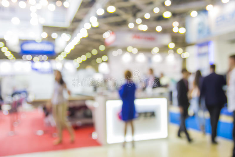 Trade show people. Intentionaly blurred background royalty free stock image