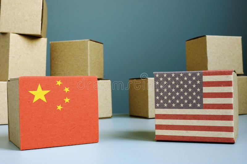 Trade war for balance between USA and China. Cardboard boxes royalty free stock photography