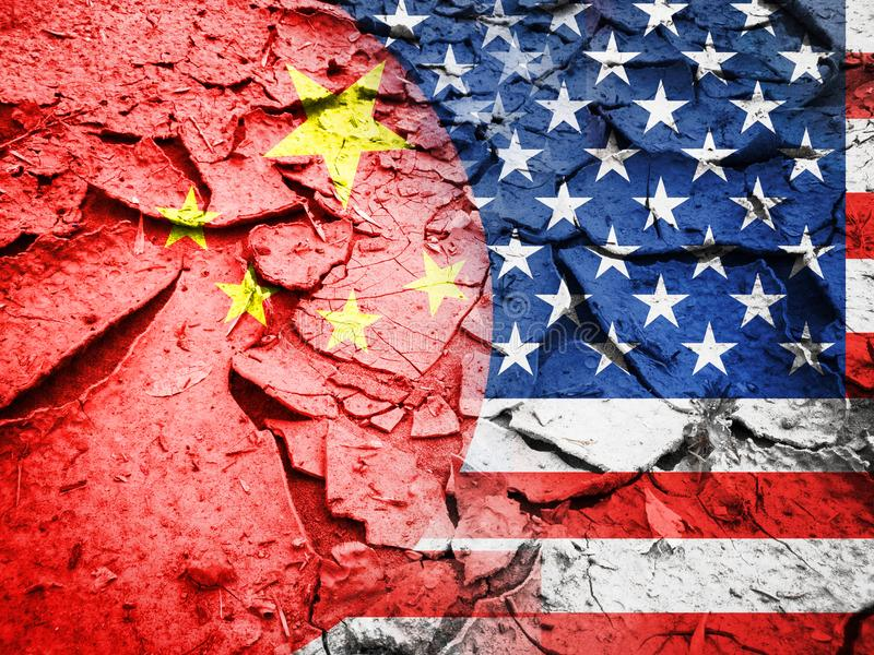 Trade war concept. USA flag against China flag, on dry cracked earth background royalty free stock photography
