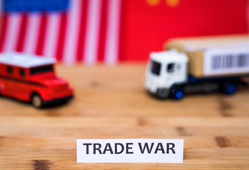 Trade War shipping concept with trucks and USA and China flag in background. Trade War shipping business concept with USA and China flag in background.  Tariffs royalty free stock images