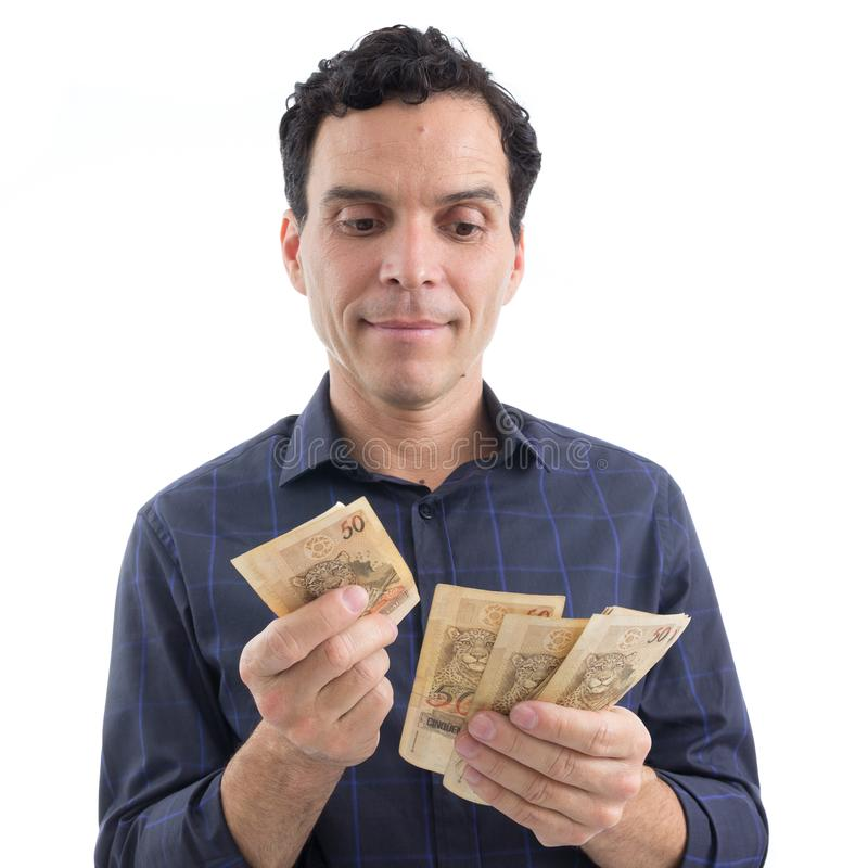 Trader is counting money. Currency: Real. The person is wearing stock photos