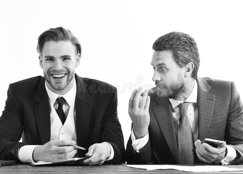 Trader, market, finance, success concept. Happy client signs contract with realtor. Real estate agent and young businessman with smiling face. Sale manager and stock images