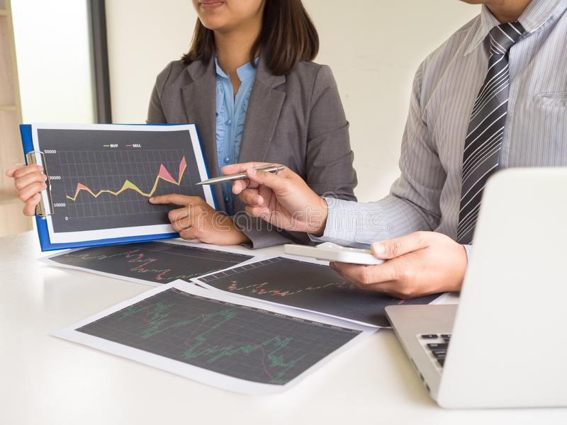 Trader team discussion and analyze stock graph report, set targets for online trading management success.  stock image