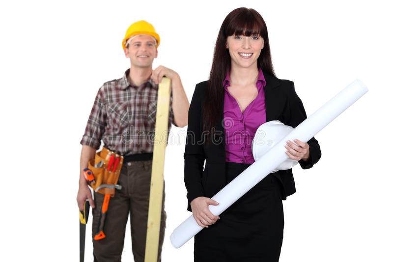 Download Tradesman Admiring A Female Engineer Stock Image - Image: 26645183