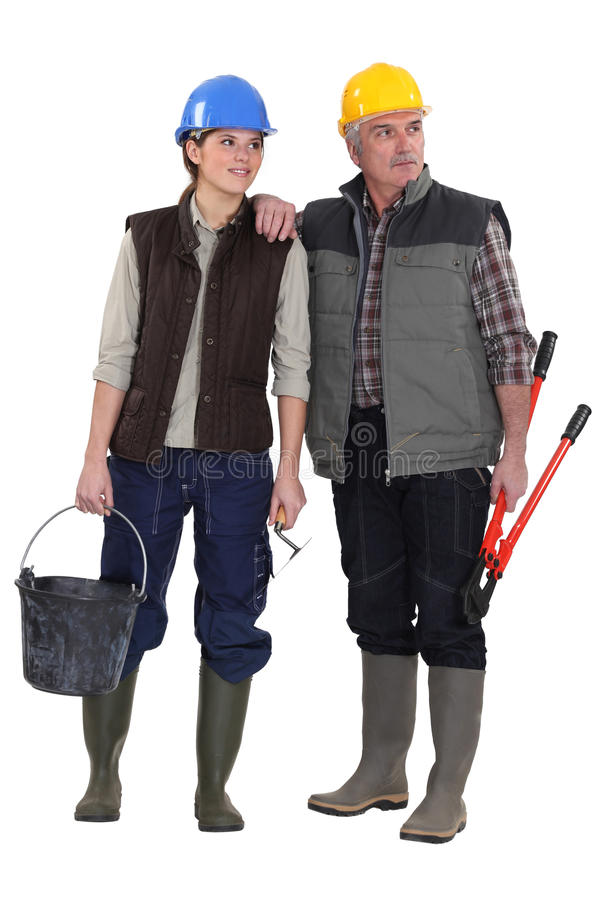 Tradesman and his assistant. Staring sideways stock images