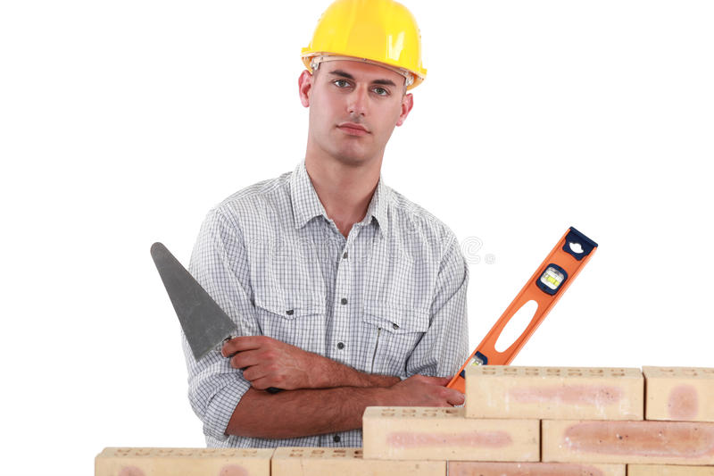 Tradesman holding a bubble level stock photography