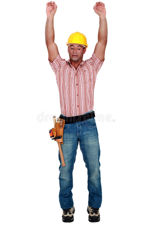 Tradesman stretching. His arms above his head stock photo
