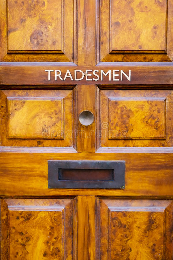 Tradesmen's entrance door. A traditional tradesmen's door, Shoreditch, City of London stock photo