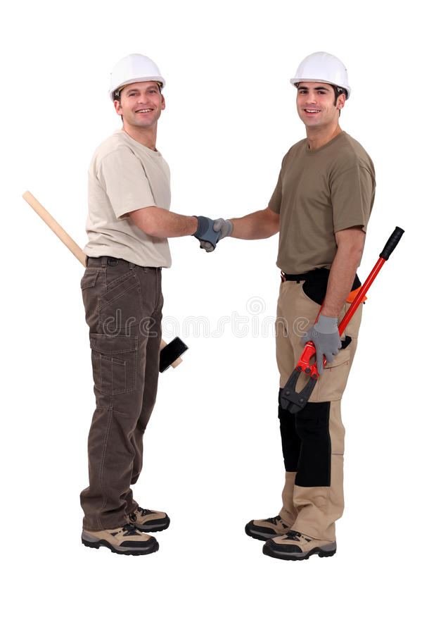 Tradesmen shaking hands. As a welcoming gesture royalty free stock photography