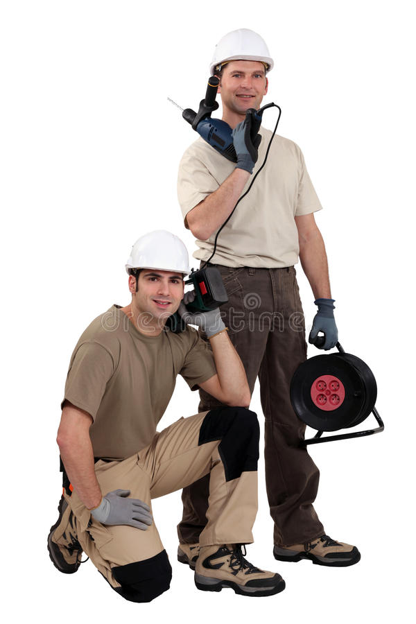 Tradesmen with their tools. Tradesmen posing with their tools stock photos