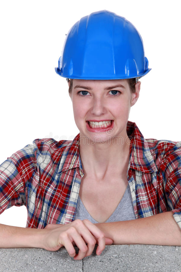 Tradeswoman baring her teeth. For the camera royalty free stock photography