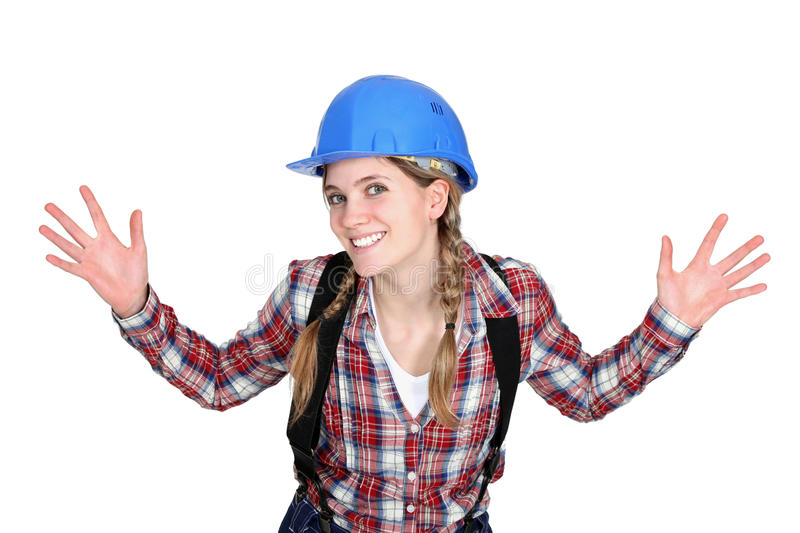 Tradeswoman holding up her hands stock image