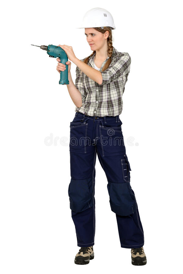 Tradeswoman using a drill. Tradeswoman holding a power tool stock images
